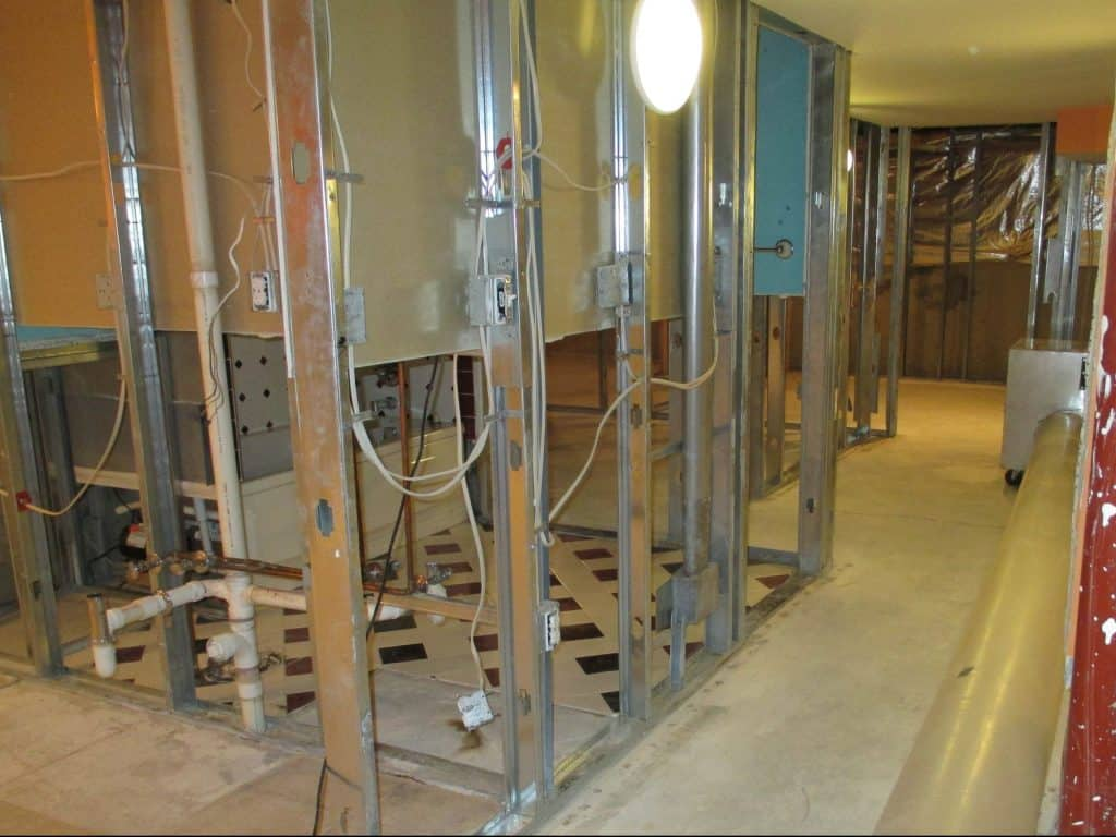 Clean basement with portions of walls removed in the mold remediation process