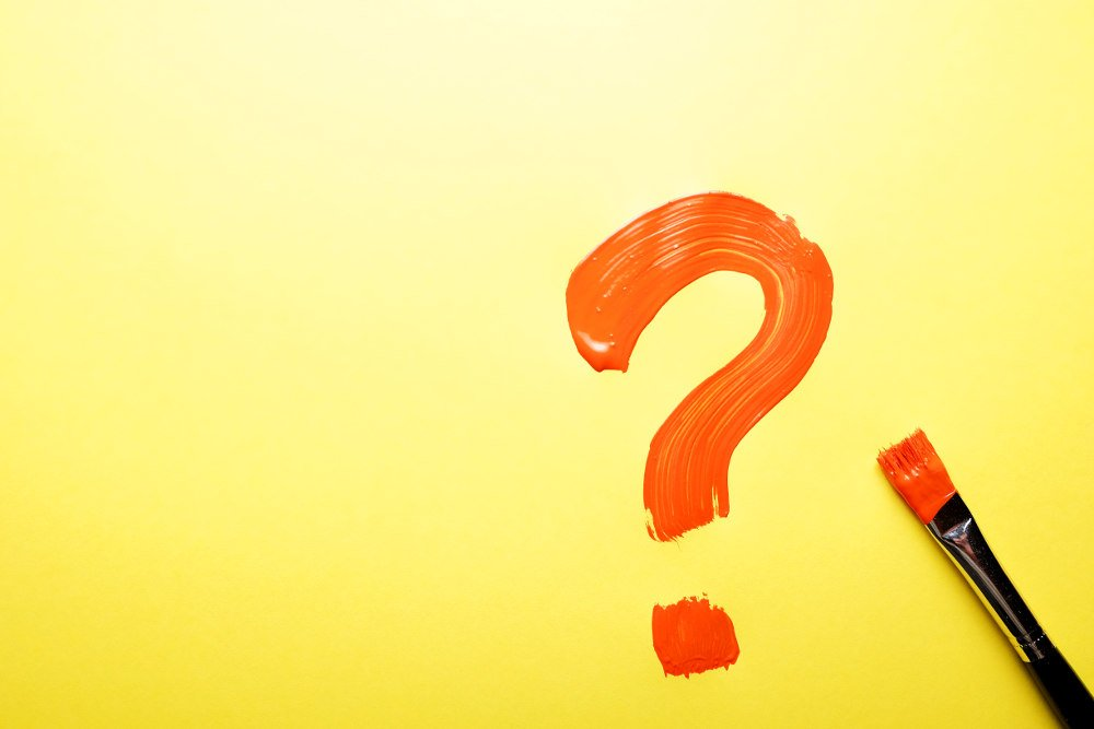 red question mark with yellow background